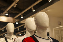 Three White Mannequin Heads Ha...