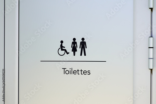 Leinwand Poster Restroom door sign toilet male female and cripple public