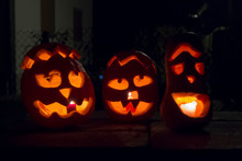 Illuminated Jack O Lanterns In Darkroom
