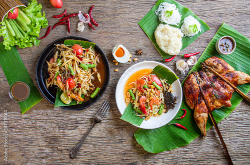 Thai papaya salad is served with grilled chicken, sticky rice, Asian food, Thai Canvas Print