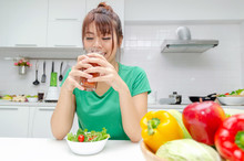 Pretty Asian Woman Slim Body In Green Shirt Dieting And Drinking Homemade Detox Juice With Fresh Vegetable Salad Sitting In At House, Lifestyle, Good Healthy, Diet Food, Fruit Juice And Drink Concept
