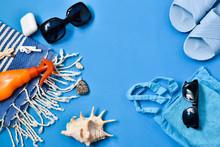 Beach Accessories On A Blue Ba...