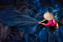 Asian Girl Sew The Fishnet. Fisherman Woman Repairs Fishing Net. Needle With Thread In Fisherman Hand Repairing Net In Home.