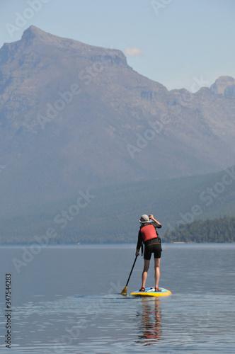 Vászonkép A stand up paddler on Lake McDonald in Glacier National Park, Montana, USA
