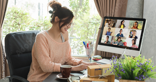 Fototapeta Asian woman work from home during corona virus, COVID-19 out break use laptop for teleconference with her teamates obraz