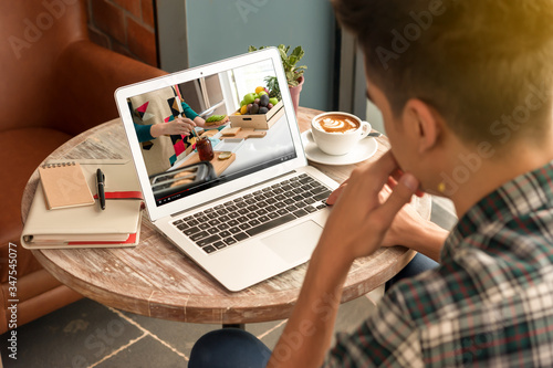 Photo Man attend course online of young teenager teach about cooking healthy food