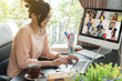 Leinwanddruck Bild - Asian woman work from home during corona virus, COVID-19 out break use laptop for teleconference with her teamates