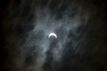 Partial Solar Eclipse In Clouds