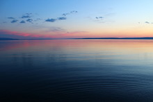 Scenic View Of Yellowstone Lake During Sunset Against Sky