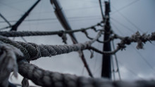 Low Angle View Of Ropes And Cables Against Sky