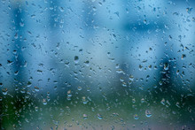 Raindrops On A Window Glass On A Rainy Day. Rain, Cloudy Day, Sadness, Longing, Depression Concept.