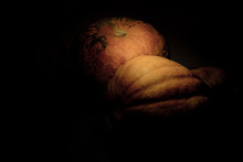 Still Life Big Pumpkins On The Table Against A Dark Background