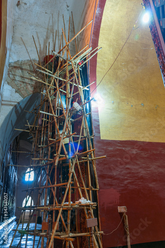 Fotografía Myanmar Travel Images, Bamboo scaffolding inside Asian building for carrying out restoration work
