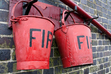 Close-up Of Fire Red Buckets