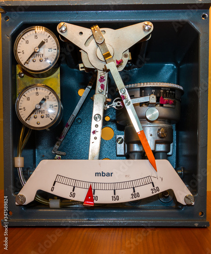 Photo Old instrument formerly used to set industrial gas pressure to a precise value