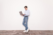 Business Man Holding A Laptop Isolated Over A White Background