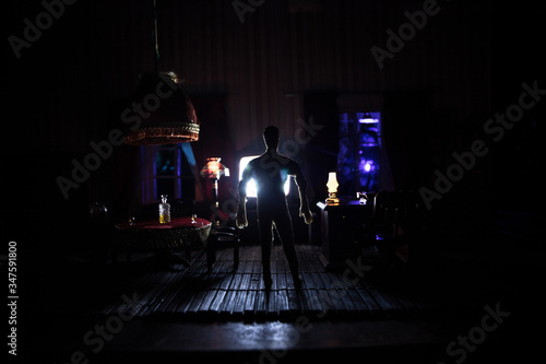 A realistic dollhouse living room with furniture and window at night Canvas-taulu