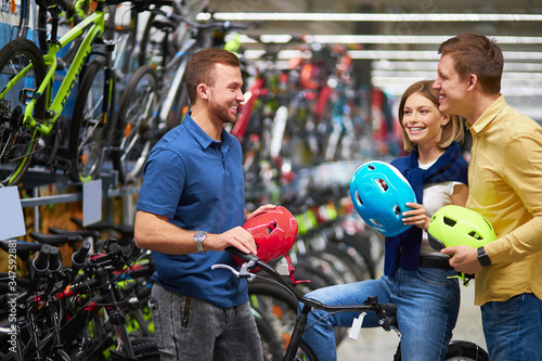 helpful responsive salesman consult customers, help to make choice, talk about a Canvas Print