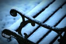 Close-up Of Snow On Bench