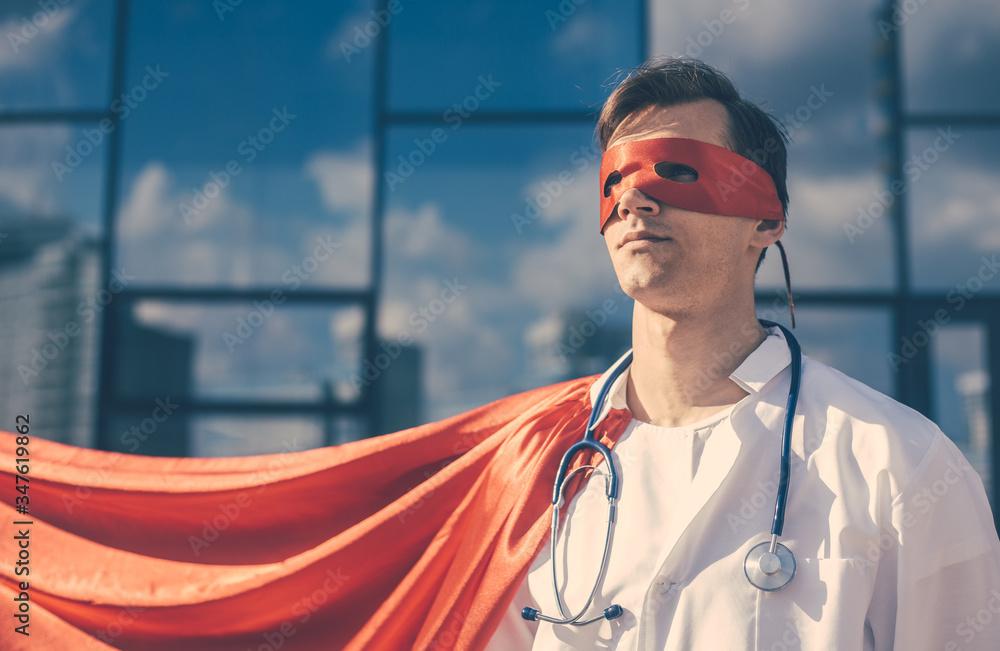 Fototapeta doctor hero in a Superman Cape standing on a city street.