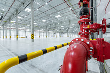 Fire Suppresion System In A Empty Industrial Hall Red Pipes And Bariers