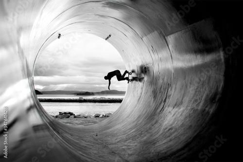 Person Skateboarding In Tunnel