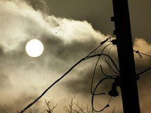 Low Angle View Of Electricity Pylon Against Full Moon In Sky