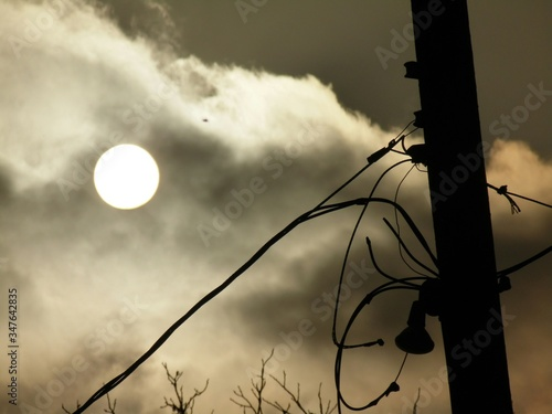 Fototapeta Low Angle View Of Electricity Pylon Against Full Moon In Sky