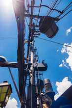 View From Below Of Metal Aluminium Mast Of The Sailing Boat Against Blue Clear Sky