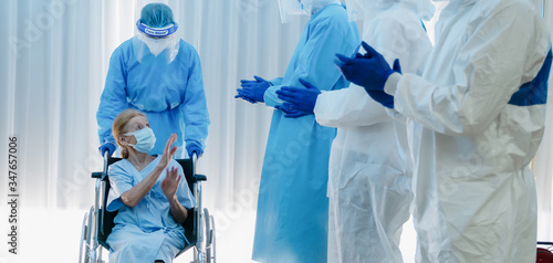 caucasian senior coronavirus covid-19 infected patient sitting on wheel chair wi Canvas