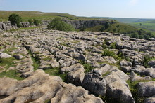 Malham Cove On Landscape Against Sky