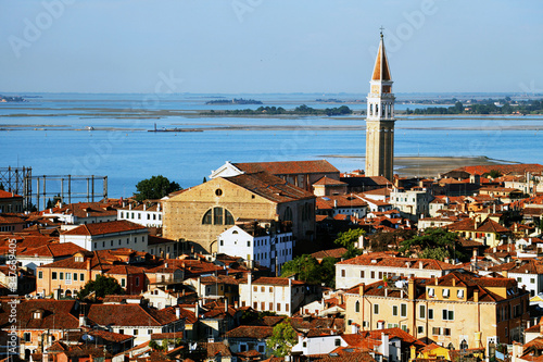 Foto Church Tower In City By Sea Against Clear Sky