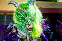 Closeup Man In Green Demon Cos...