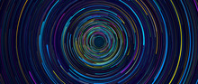 Background Of Light Lines Of Blue, Green, Yellow And Purple Color Of Different Sizes Rotating In Circles On A Black Background Forming A Tunnel. 3D Illustration