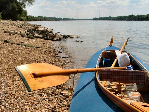 Canvas Print Boat Moored At Riverbank On Sunny Day