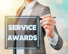 Conceptual Hand Writing Showing Service Awards. Concept Meaning Recognizing An Employee For His Or Her Longevity Or Tenure