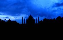 Silhouette Taj Mahal Against Dramatic Sky During Sunset