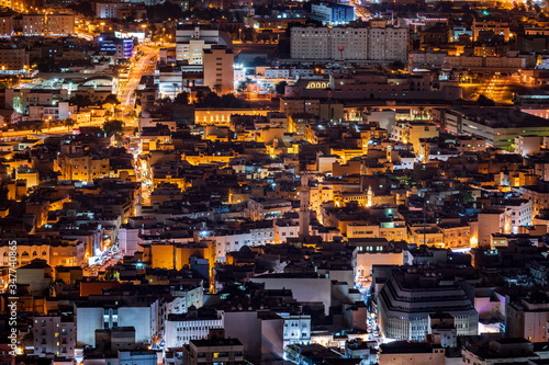 Ariel view of Downtown Manama at night, the capital of Bahrain Wallpaper Mural