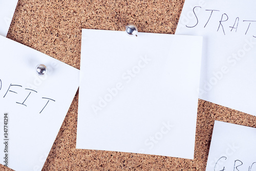 Top view of reminder sticky notes attaching to cork board Canvas Print