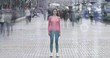 The young girl is standing in crowdy flow on holographic background. time lapse