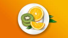 Sliced Kiwi And Orange On A White Plate.