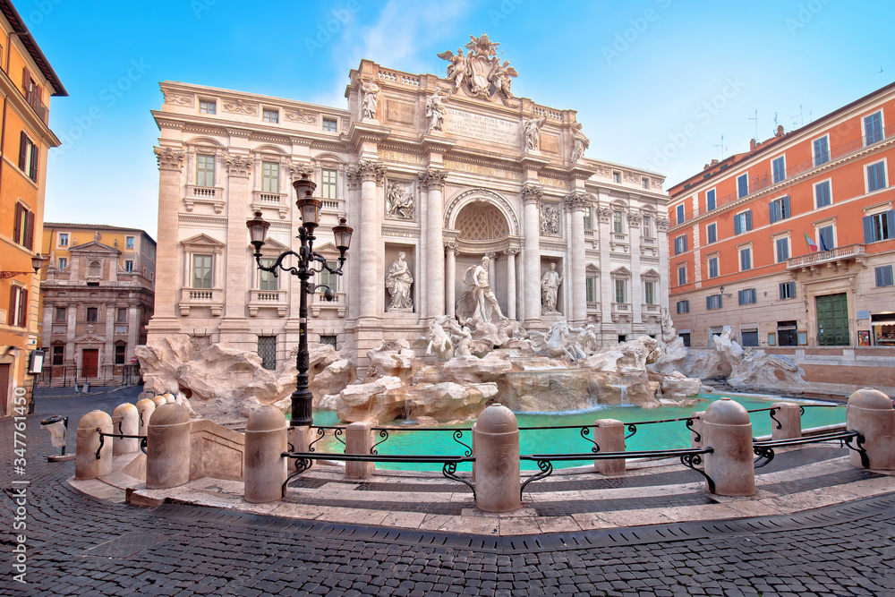 Empty streets of Rome. Majestic Trevi fountain in Rome street view