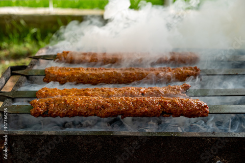 Traditional Turkish Adana  Kebap on the grill with skewers  for dinner Canvas Print