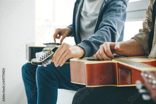 Learning to play the guitar Slika na platnu