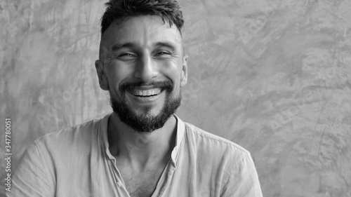Cuadros en Lienzo Portrait of a happy adult smiling handsome man in 30's looking in  camera, Indoo