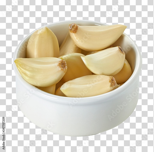 Garlic cloves in bowl from top on isolated background including clipping path Canvas-taulu