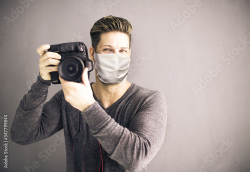 photographer with camera and face mask Wallpaper Mural