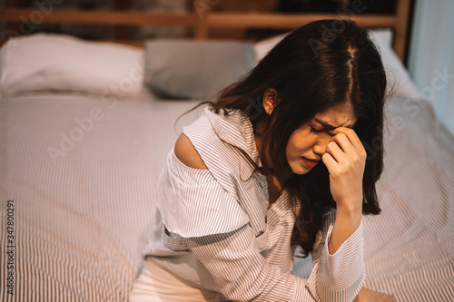 Fototapety, obrazy: Portrait of 20s young Asian woman suffering pain and medical sickness in bedroom at night. Fever, high temperature, cold, migraine, tiredness, symptoms