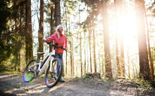 Active Senior Woman With E-bike Cycling Outdoors In Nature.