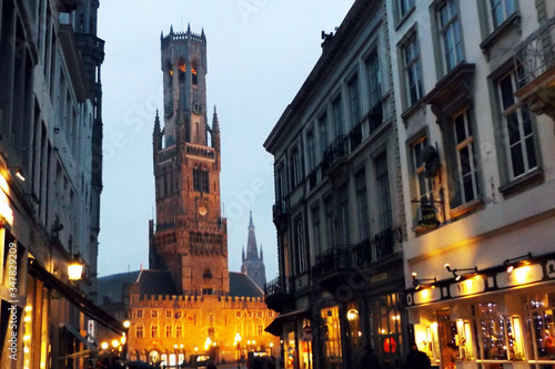 Photographie Illuminated Belfry Of Bruges At Dusk